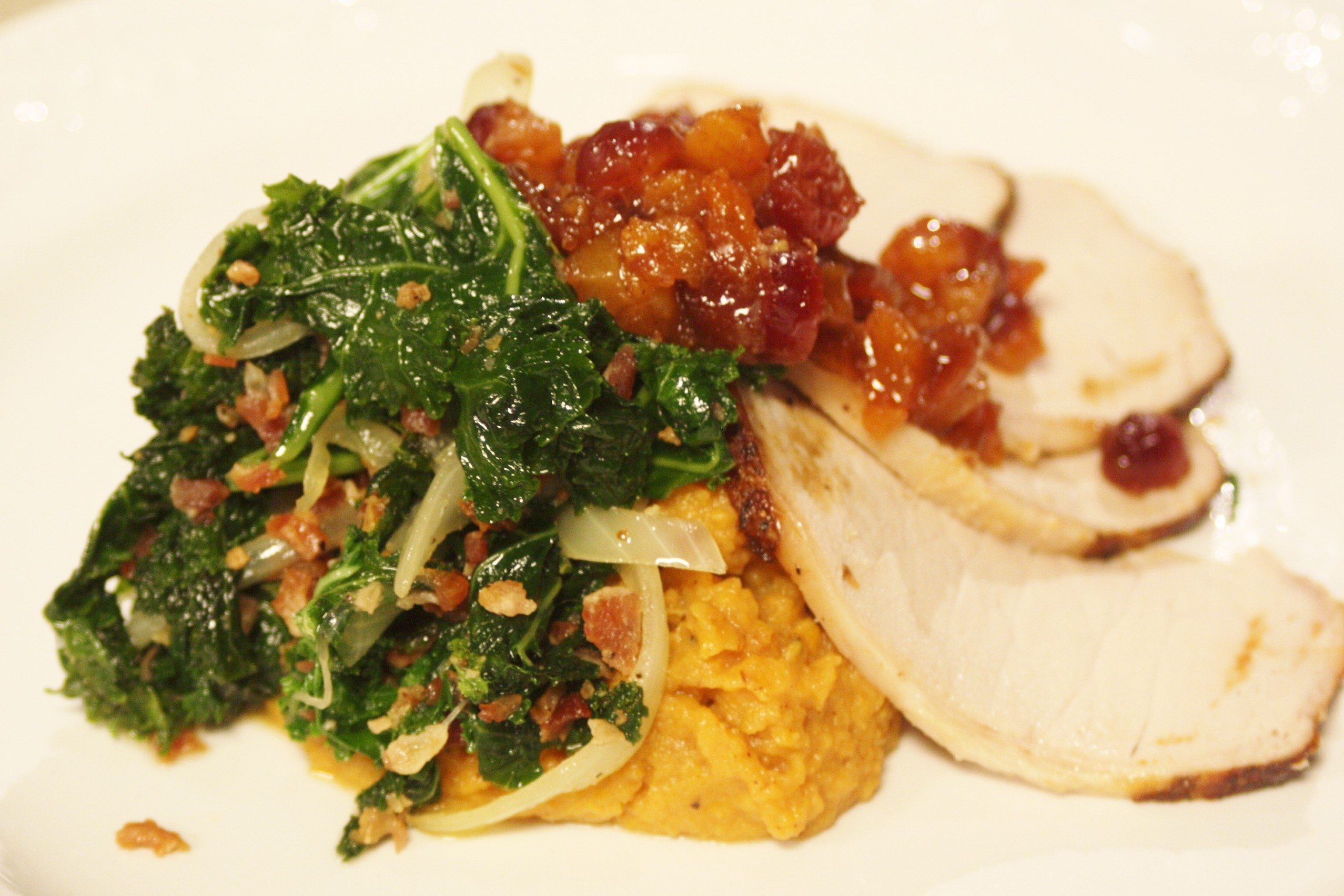 Roasted Loin of Pork with Sweet Potato Mash, Wilted Kale, and Maple Cranberry & Apple Chutney